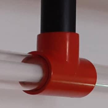 Rood koppelstuk van een Koppelbare Design lamp